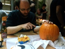 Alex carving a jack-o-lantern for the first time